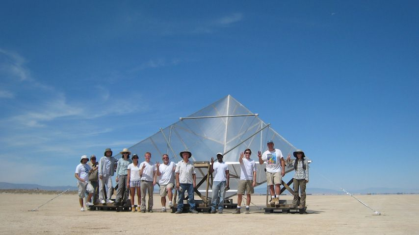 Large 4.8-meter corner reflector towers over the group of a dozen people who built it